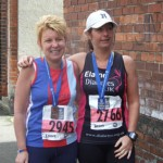 Deborah Hill and Elaine McKee with their Belfast Marathon medals