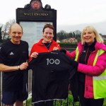 Jean Dolan receiving her 100 Park Run T-shirt at The Waterworks from Matt Shields and Mags Mathieson