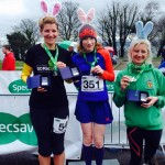Louise Smart receiving her 3rd place 5k Easter Bunny Race medal