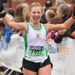 Christine Murray finishing the Asics Greater Manchester Marathon